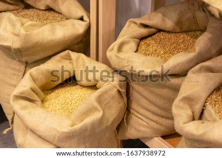 Select grain in bags before grinding. Food