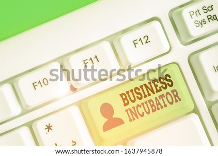 Conceptual hand writing showing Business Incubator. Business photo text company that helps new and startup companies to develop. #1637945878