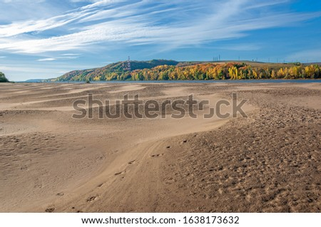 Autumn landscape river sandy shores, rifts and stretches, dark blue cold water, a sad time to catch eyes, a colorful farewell to the summer #1638173632