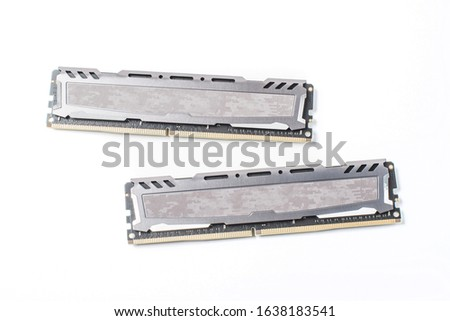 Photo of of two DDR4 RAM (Random Access Memory) computer memory modules on white background, microelectronic chipset close up, computer circuit detail, DDR board #1638183541