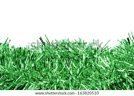 Garlands of green tinsel over white as a background #163820510