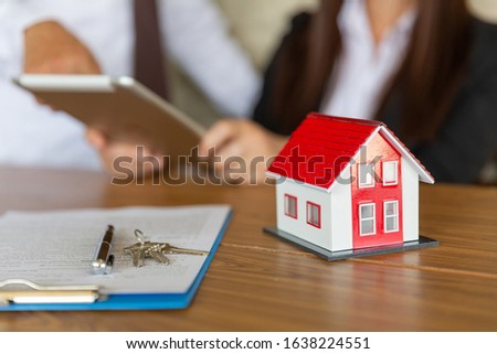 The dealer signs a contract, a contract of sale, a signature on the document, the customer who buys the product or makes a contract, the concept of buying and selling houses. #1638224551