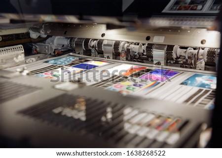 Offset printing machine, inside view, printing sheets, printing Royalty-Free Stock Photo #1638268522