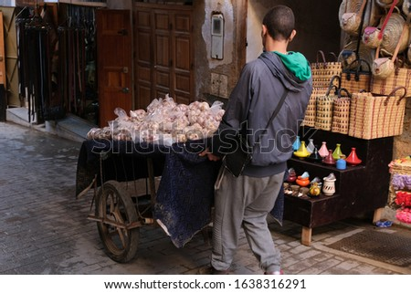 Man carries a cart of onions, Fes Marocco, Medina #1638316291