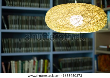Lamp in the library . Bookshelves in the background #1638450373