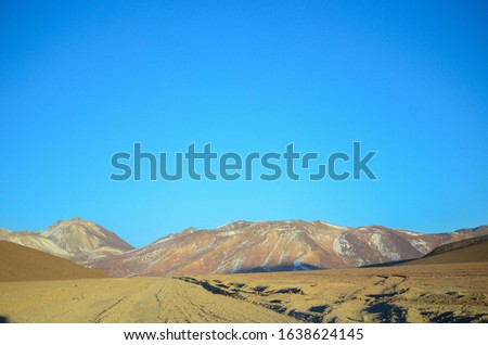 Textured Scenic Mountain Tips With Blue Sky In Bolivian Desert Minimal Photo
