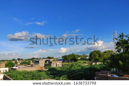 Beautiful Blue Sky with greenery on the ground. Pic of a town showing the beauty of nature.