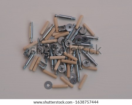 Top view arrangement group of parts (dowel, bolt, washer, screw) for ready-to-assemble wooden furniture assembly #1638757444