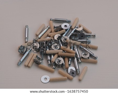 Top view arrangement group of parts (dowel, bolt, washer, screw) for ready-to-assemble wooden furniture assembly #1638757450
