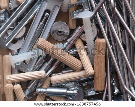 Top view arrangement group of parts (dowel, bolt, washer, screw) for ready-to-assemble wooden furniture assembly #1638757456
