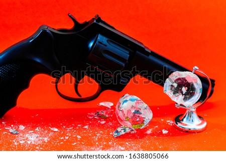 broken globe. gun and globe. #1638805066