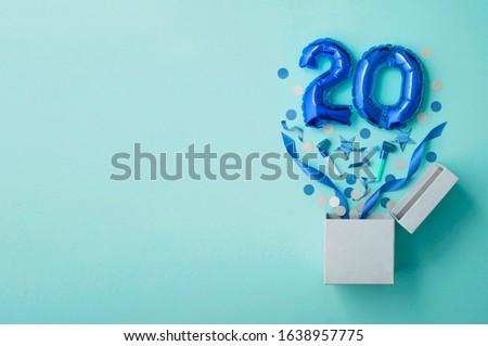 Number 20 birthday balloon celebration gift box lay flat explosion Royalty-Free Stock Photo #1638957775