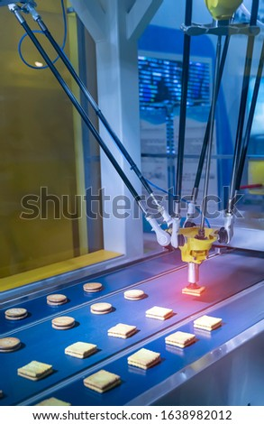 automate robot with vacuum suckers with conveyor in Production of biscuits in a manufacture factory for the food industry #1638982012