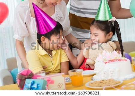 Image of funny children laughing during the family party on the foreground
