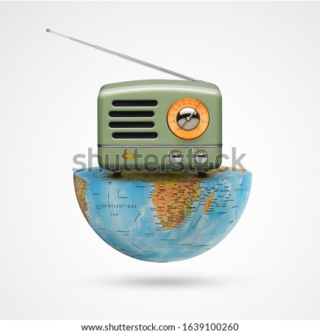 world radio day and an antique radio receptor on a  world on white background, with a retro effect, creative, concept, social communication advertising, Vintage Radio the receiver musical, celebrities Royalty-Free Stock Photo #1639100260