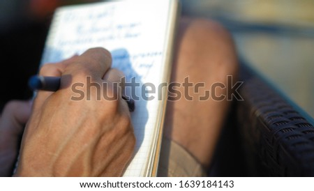 Successful man with ring writes ideas in notebook on sunny day #1639184143