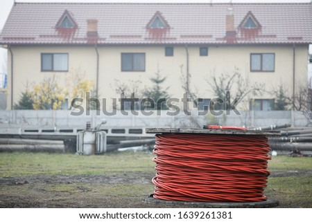 Wooden cable reels outdoors during a cold rainy day. #1639261381