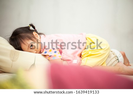 little girl laying on the bed feel angry #1639419133