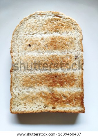 Slice of Whole Wheat Brown Toast #1639460437
