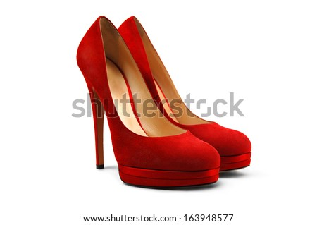 A pair of red female shoes on a white background. Royalty-Free Stock Photo #163948577