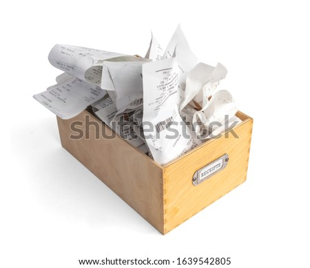 "Overfilled box of receipts for filing taxes and deductibles. Wooden storage box with ""Receipts"" label. Isolated on white.  #1639542805"