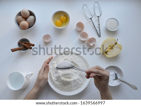Baking ingredients cooking dough for homemade apple pie. Woman preparation muffins. Bakery background top view. #1639566997