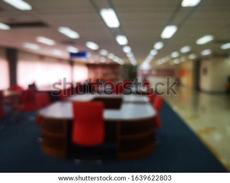 Blur or bokeh Interiors design wooden chairs and tables in the library room of university with the shelf books but nobody in the morning #1639622803