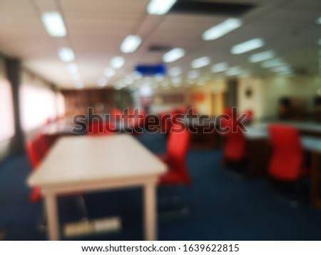 Blur or bokeh Interiors design wooden chairs and tables in the library room of university with the shelf books but nobody in the morning #1639622815