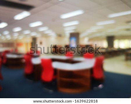 Blur or bokeh Interiors design wooden chairs and tables in the library room of university with the shelf books but nobody in the morning #1639622818