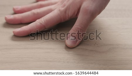 man hand touches black walnut board #1639644484