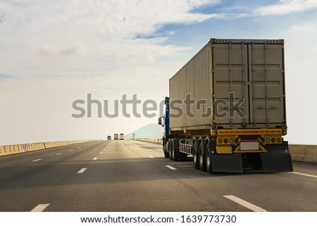 White Truck on highway road with  container, transportation concept.,import,export logistic industrial Transporting Land transport on the asphalt expressway #1639773730