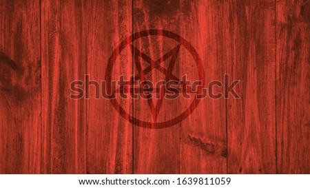 Inverted pentagram painted on a background of red wooden boards. #1639811059