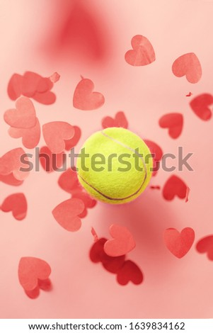 tennis love layout tennis ball flying hearts confetti. Valentine's day concept with tennis play. Vertical formatting #1639834162