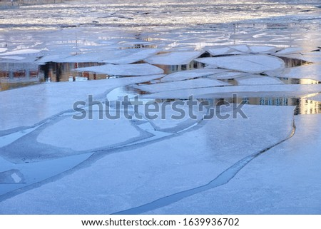 Melting ice floes on the river #1639936702