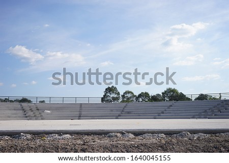 observatory planetarium telescope grand stand sitting stairs area day scene look through space, build construction with white gray concrete minimalism architecture style and blue sky as background. #1640045155