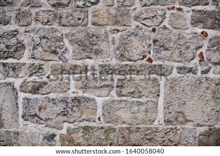 Texture of a stone wall. Old castle stone wall texture background. Stone wall as a background or texture. Part of a stone wall, for background or texture Royalty-Free Stock Photo #1640058040