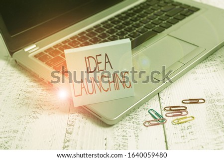 Handwriting text Idea Launching. Concept meaning to begin something new such as a plan or business venture Trendy metallic laptop blank sticky pad clips lying wooden vintage table. #1640059480