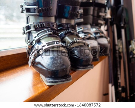 Ski boots rental, skis and poles. Skiing equipment rented. Close up #1640087572