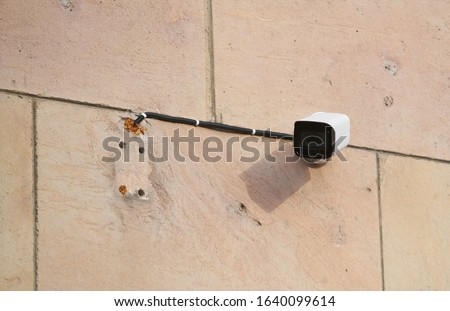 Security Camera, CCTV on location. Security camera on the wall in old city. Royalty-Free Stock Photo #1640099614