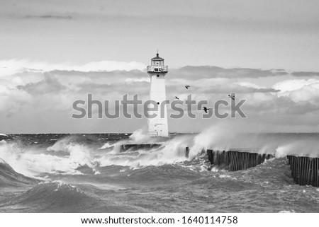 Sodas point lighthouse in Oswego New York on a windy day #1640114758