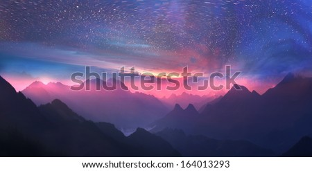 Wild alpine peaks rows away to the horizon, forming a magical panoramic view, resulting in amazement climber.Whirling stars at slow shutter speeds  sunsets against the mountain waves - just incredible #164013293
