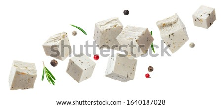 Falling greek feta cubes with herbs and spices, diced soft cheese isolated on white background #1640187028