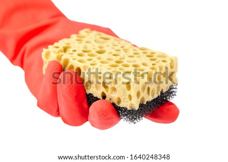 Household sponge from reticulated foam isolated on white background. Hand in red rubber glove holding a yellow black sponge for washing dishes #1640248348
