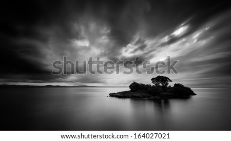 Black and white photo of a lonely Caribbean island in Cayo Levantado, Dominican Republic.