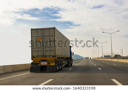White Truck on highway road with  container, transportation concept.,import,export logistic industrial Transporting Land transport on the asphalt expressway #1640323198