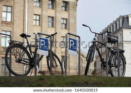 Bicycle secured on a parking in a city. Royalty-Free Stock Photo #1640500819