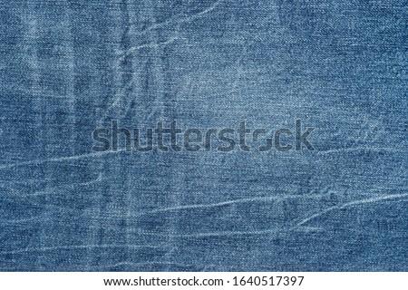 Blue jeans fabric. Denim jeans texture of denim jeans background. Denim jeans for fashion design #1640517397