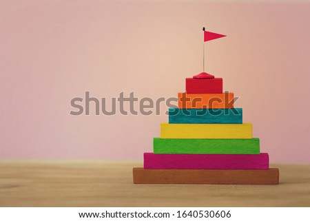 Arrange red flag on stair step go to Trophy and success. Staircase to success.  #1640530606