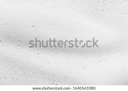 White foam texture background. Cleanser, soap, shampoo bubbles closeup. Foamy skin care product sample #1640561080