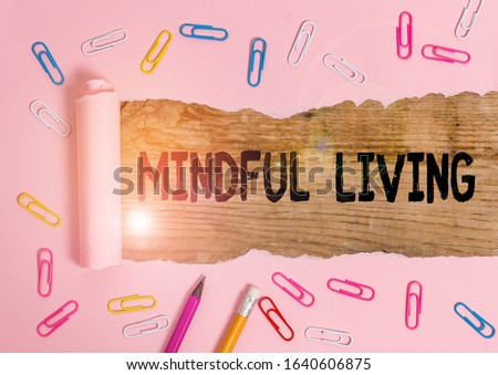 Text sign showing Mindful Living. Conceptual photo Having a sense of purpose and setting goals in life Stationary and torn cardboard placed above a wooden classic table backdrop. #1640606875